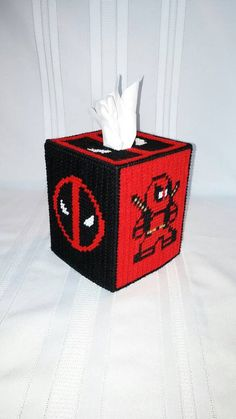 Check out this item in my Etsy shop https://www.etsy.com/listing/270975835/deadpool-tissue-box-cover