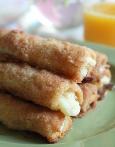 Crack Sticks aka Cinnamon Cream Cheese Roll-Ups: Oh My Goodness! These are so easy and OH MY YUMMY GOOD…just white bread, crusts removed & flattened, spread w sweetened cream cheese, rolled jelly roll style, then dipped in cinnamon sugar & baked until crispy crunchy & cream cheese is hot & oozing. Delicious finger food for a brunch or shower