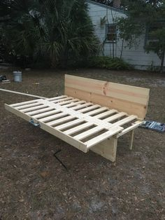 DIY pine wood slat bed in sleep position