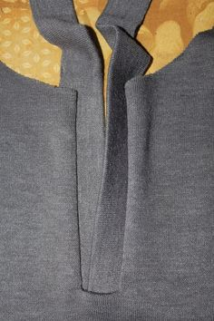 knitted placket front and neck band