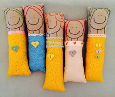 ButtonMad These sweet little dolls are so easy to make from your pile of scraps. Simply trace and embroider her big smile and hair onto a scrap of linen then sew that to a brightly colored piece for her dress. Add some ribbon or lace if you'd like and sew on a few handmade Incomparable buttons.