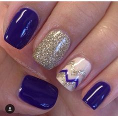 Cute navy blue and gold nail design