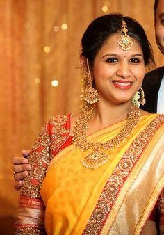 South Indian bride. Temple Indian bridal jewelry. Jhumkis.Yellow silk kanchipuram sari with pink blouse.Braid with fresh jasmine flowers. Tamil bride. Telugu bride. Kannada bride. Hindu bride. Malayalee bride.Kerala bride.South Indian wedding.