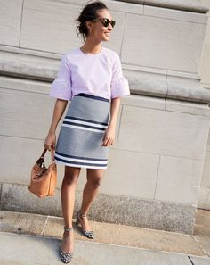 J.Crew women's button-back bell-sleeve top, A-line skirt in striped navy tweed, disc hoop earrings, Sam sunglasses, Hobo bag and leopard-print heels.