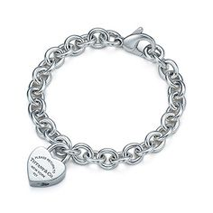 Return to Tiffany™ heart lock charm on a round link bracelet in sterling silver. My 14th wedding anniversary present. <3