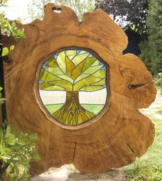 http://fashion881.blogspot.com - Stained glass tree made from recycled wine bottle glass inserted into tree bole - slice taken from tree root.