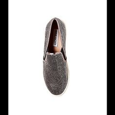 STEVE MADDEN EXSESS SLIP ON W/ CRYSTAL BLING NIB 9 Show off your fierce attitude with EXSESS, the perfect slip on sneaker with a comfortable rubber outsole and crystal adorned upper. Size 9 Gorgeous and Comfortable Man-made upper material Man-made lining Man-made sole 1 inch platform Closed toe slip-on sneaker Allover crystal stud details Elastic gore insets at sides Steve Madden Shoes Sneakers