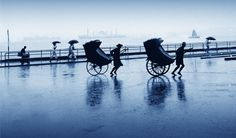 Fan Ho ~ Rickshaws in Rain