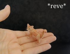 This tiny playful Tabby Cat is an original sculpture formed by hand using polymer clay as a base with delicate wire armature in legs, neck and tail. Tail can be gently posed. After pain...