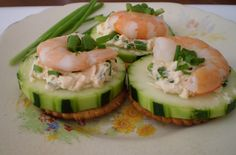 sliced cucumber, philly cheese with a little thousand island dressing and chopped chives. prawn on top and a few chives. I used a thin cracker which is optional,