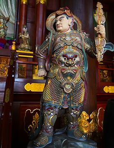 """Late Tang armor of a warrior encased in by what then had became the """"mountain scale"""" or """"mountain pattern"""" armor. He wears a Tang era cap."""