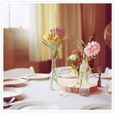 wood block and simple flower vase centerpieces