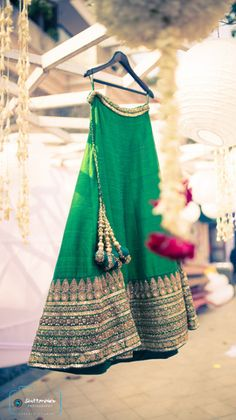 Bridal Lehengas - Parrot Green Lehenga | WedMeGood Parrot Green Silk Lehenga with Gold Embroidery Borders and Peacock Green Pom Poms. #wedmegood #bridal #lehenga #pompoms
