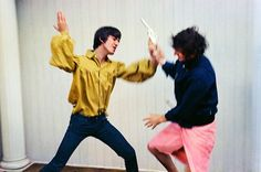 In 1964, George Harrison and Ringo Starr have a mock fight for the camera in Bel Air.