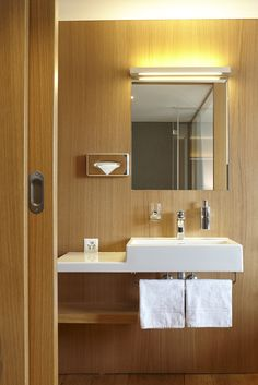 Nearly all of the bathrooms at East West Hotel in Basel are fitted with washbasins from Laufen's Living City collection; they feature clear-cut, geometric lines and a 40 centimetre-wide, integrated ceramic shelf surface. www.laufen.com