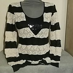 Black and white sweater Cute top with  high low style  In really good condition  Self is 100% polyester  Contrast is 80% polyester  16% RAYON  4% spandex  Lining is 100% polyester  From a smoke free home Pet friendly home living doll Sweaters Crew & Scoop Necks