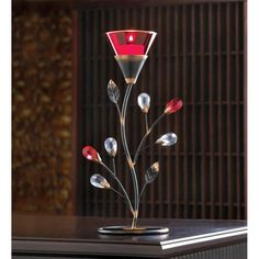 Ruby Blossom Tealight Candle Holder - Perched atop a slender bejeweled stem, a rich red flower casts a romantic ruby glow. This Ruby Blossom Tealight Candle Holder is a stunning accent that adds lovely luster to any setting! Glass Tea Light Holders, Tealight Candle Holders, Tea Light Candles, Tea Lights, Candleholders, Outdoor Candle Lanterns, Lanterns Decor, Wholesale Candle Holders, Hobby Lobby Lanterns