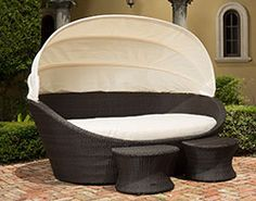The Hampton Day Bed with retractable canopy features pair of matching stools and elegant curved design. Outdoor Daybed, Outdoor Furniture, Outdoor Decor, Seat Cushions, Retractable Canopy, Table Seating, Cozy Place, End Tables, Mesas