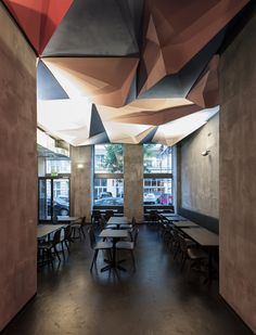 If Dogs Run Free by Tzou Lubroth Architekten. Local architects Gregorio S. Lubroth and Chieh-shu Tzou teamed up with three friends to design, build and launch the bar themselves, before adding the spiky ceiling as the first in a series of installations by different artists and designers.