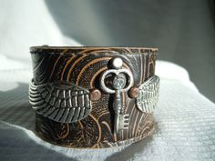 Winged+Key+Steampunk+Recycled+Stamped+Leather+Cuff+by+TimeFound,+$14.00