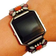 Fitbit Blaze Jewelry - Fitness Tracker Accessory Bracelet - Bold Flower Purple Orange White Stone Rhinestone Embellished ZAMBIA Fitbit Charm Accessory. This beautiful charm is handmade to order. It is designed to be snugly secured against your fitness tracker to amplify your look! Instead of wearing a sporty and bare plastic Fitbit BLAZE band, add to your unique style with the bracelets of Weekend Wearables. This product offers the ease and capability of allowing the charm to remain on…