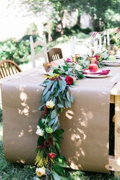 A butcher paper table runner and mismatched vintage chairs make for an informal yet elegant design, without breaking the bank.Via Style Me Pretty Spring Wedding Centerpieces, Wedding Decorations, Table Decorations, Garland Wedding, Table Garland, Butcher Paper, Kraft Paper Wedding, Paper Tablecloth, Tablecloths