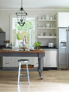 ikea cabinets! love it all - white, farmhouse sink, open shelving, grey island.