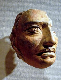 Gupta Period (गुप्त राजवंश) fragment from a relief a male head about 4 inches H. Terracotta India, 6th C. Met