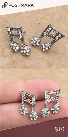 Silver Tone Crystal Music Musical Note Studs Silver Tone crystal musical music notes set with glittering clear crystals.  Earrings feature posts with friction backs and measure 3/4 inch L x 3/8 inch W. Jewelry Earrings