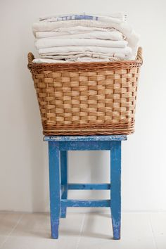 blue stool with antique straw basket, heirloom collection of antique linen. via design sponge Linen Baskets, Laundry Baskets, Laundry Rooms, Painted Baskets, Vintage Laundry, Linen Storage, Red Barns, Farmhouse Chic, Country Decor