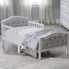 """Padded and upholstered head and footboard Upholstery is ultra-soft micro-fiber polyester Decorative """"crystal"""" Dimensions: x x in white finish Fits a standard crib mattress. Home décor, baby crib, baby bedroom Wooden Toddler Bed, White Toddler Bed, Toddler Girl Beds, Toddler Rooms, Baby Crib Mattress, Baby Cribs, Kids Bedroom Furniture, Furniture Decor, Outdoor Furniture"""