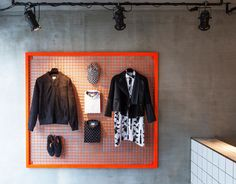 Creative Retail Store Design Using OSB and Tile – Design Milk - Clothing Store Interior, Clothing Store Design, Boutique Interior, Designer Clothing, Visual Merchandising, Suit Stores, Retail Store Design, Retail Stores, Store Interiors