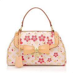 This collectible Louis Vuitton Sac Retro satchel is in Pre-Loved condition. It is made from soft pink Cherry Blossom coated canvas trimmed in natural leather and accented with golden brass hardware. Monogram Cherry Blossom is a limited edition line from the Spring/Summer 2003 Collection.