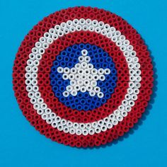 Perler Bead Captain America Shield. I want to make one for Bucky/the Winter Soldier.