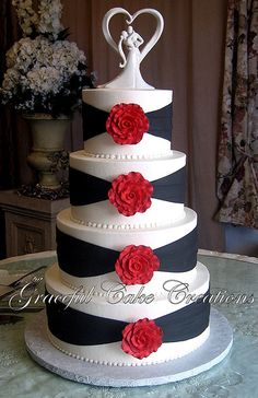 Elegant White and Black Wedding Cake with Red Roses