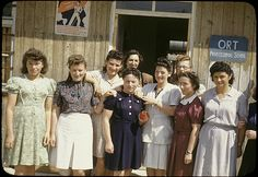 1940s - Group portrait of Jewish women standing outside the ORT school in the Feldafing displaced persons camp.
