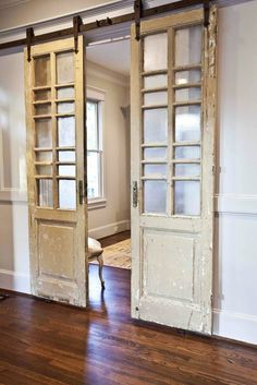 Reclaimed doors hung like barn doors