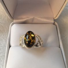 New! Sterling Silver & Genuine Green Amber Ring Gorgeous! Sterling Silver and Genuine Green Amber Ring. Never Worn. Jewelry Rings