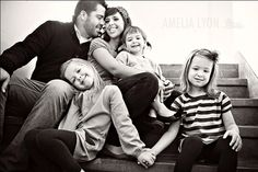 50 Outstanding Examples Of Family Photography   AntsMagazine.Com - - - parents 3kids, multi level on stairs, two oldest kids holding hanfd