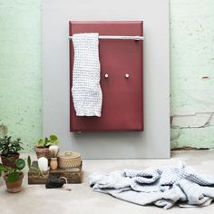 Towel radiator for kitchen and bathroom in beautiful red.