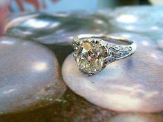 2.32 carat VS-2, J cushion cut diamond platinum ring from the 1920's at Walton's