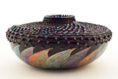 The Gourd Art Festival - The world's largest festival of gourds!  basket design attached to gourd, holes punched