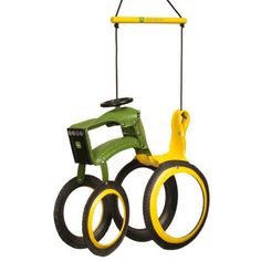 This swing is perfect for young John Deere fans! Made with a recycled tire, the John Deere Tractor Tire Swing is completed with bright green and yellow paint. It even proudly displays the John Deere logo! Tyres Recycle, Recycled Tires, Recycle Crafts, Reuse Recycle, Recycled Art, Swing Set Accessories, Kayak Accessories, Tire Art, Tractor Tire