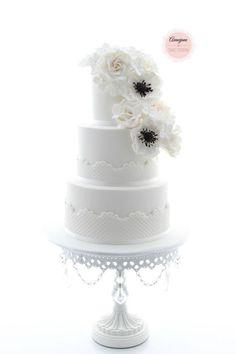 Aimeejane Cake Design | white anemone flower | white wedding cake | white chandelier cake stand by Opulent Treasures