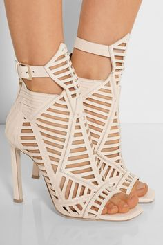 Daniele Michetti | Cutout leather sandals | NET-A-PORTER.COM. Daniele Michetti's leather sandals are a refined take on gladiator styles. This beige pair has a high-rise ankle, geometric laser cutouts and a square open toe.