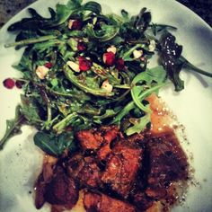 Slow Cook Pork Shoulder with Arugula, Dried Cranberries, Feta cheese salad with balsamic vinaigrette.