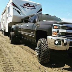 Lifted black chevy Silverado 3500 Dually duramax diesel towing, pulling fifth wheel, camper Jacked Up Trucks, Dually Trucks, Chevy Pickup Trucks, Gm Trucks, Chevrolet Trucks, Diesel Trucks, Cool Trucks, Dodge Diesel, Lifted Jeeps