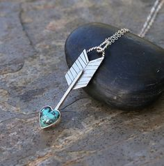 Sometimes we get pulled back before we can soar~ Handcrafted from start to finish, I used all sterling silver for this piece. A heart shaped turquoise