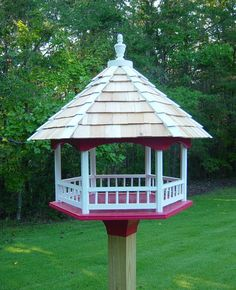 platform fly thru bird feeder. Could use this with some sort of half barrel planter at the bottom for a well pipe cover