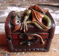 dragon guarding a treasure box, love his expression